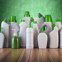 stock-photo-natural-green-detergent-bottles-or-containers-cleaning-supplies-on-green-background-d-572028577